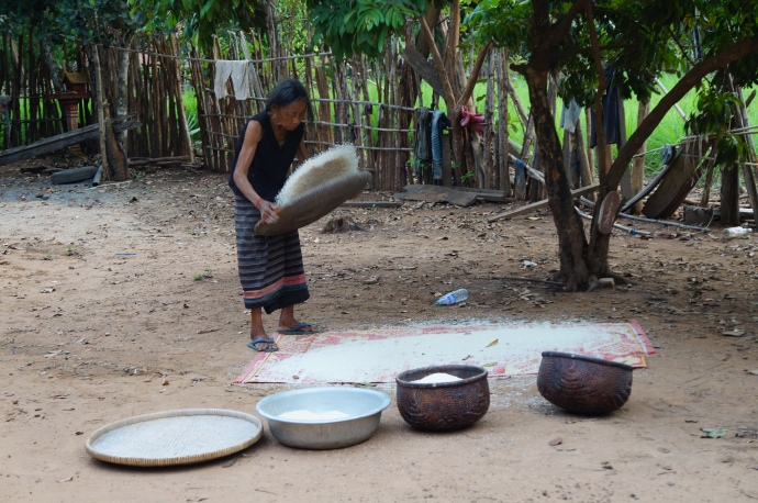 Our local host family sorting the rice